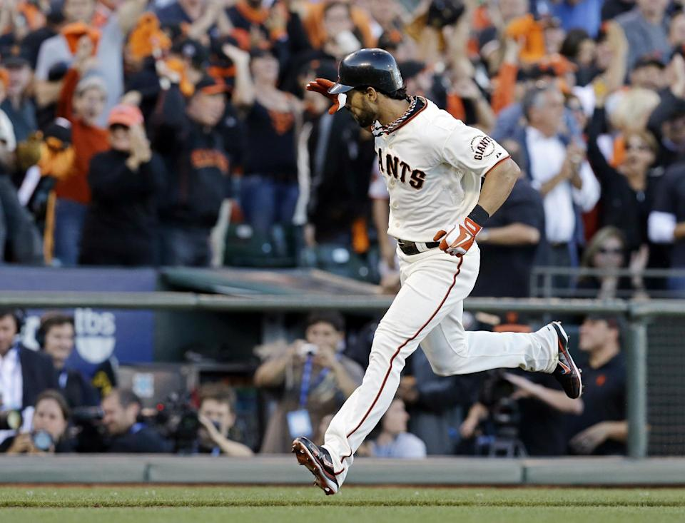 San Francisco Giants' Angel Pagan reacts after hitting a home run during the first inning of Game 2 of baseball's National League championship series against the St. Louis Cardinals Monday, Oct. 15, 2012, in San Francisco. (AP Photo/David J. Phillip)
