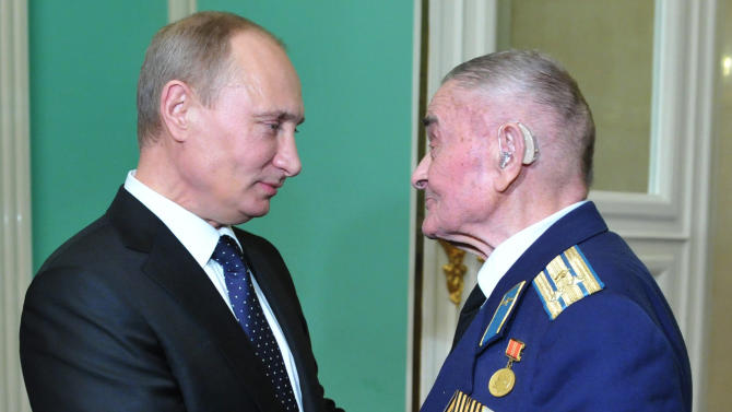 In this photo made Friday, Feb. 1, 2013, Russian President Vladimir Putin, left, speaks with World War II veteran Ilya Filatov at a reception marking the 70th anniversary of the Battle of Stalingrad, in the Kremlin in Moscow, Russia. The Battle of Stalingrad was turning point in World War II that led to the defeat of the Nazi Germany. (AP Photo/RIA-Novosti, Alexei Nikolsky, Presidential Press Service)
