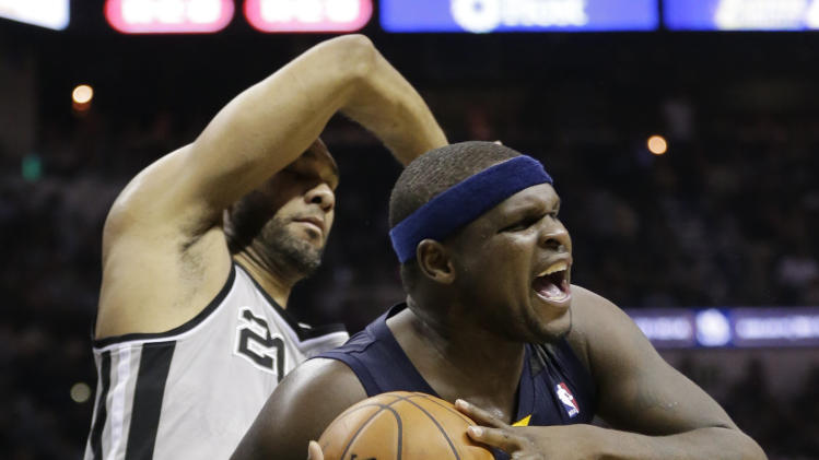 Memphis Grizzlies' Zach Randolph (50) battles for a rebound against San Antonio Spurs' Tim Duncan during the first half in Game 2 of the Western Conference finals NBA basketball playoff series, Tuesday, May 21, 2013, in San Antonio. (AP Photo/Eric Gay)