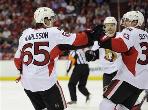 Senators clinch playoff berth by beating Caps 2-1