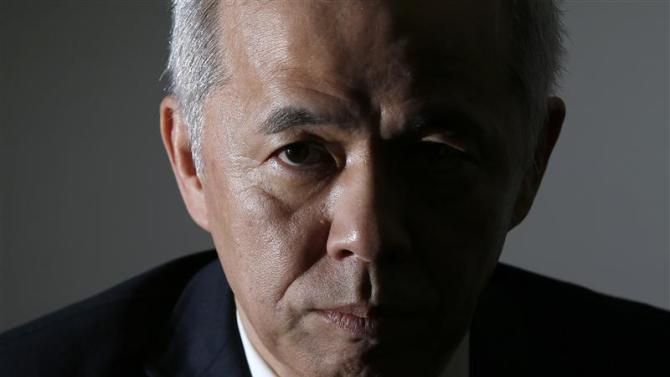 Hirose speaks during an interview with Reuters at the company's headquarters in Tokyo