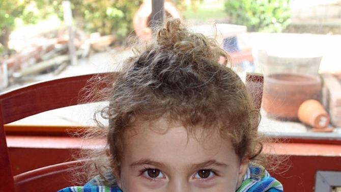 "AVIELLE RICHMAN, 6: The curly headed little girl known as Avie Richman loved a lot of things. Horses. Harry Potter. The color red. She tried archery after watching the Disney movie ""Brave."" She told her parents that her dream car was a minivan. (AP Photo/Richman Family Photo)"