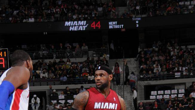 James' triple-double helps Heat pound Pistons