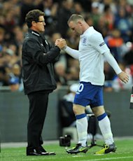 A jibe by Fabio Capello (left) at Wayne Rooney (right) has been criticised by Roy Hodgson