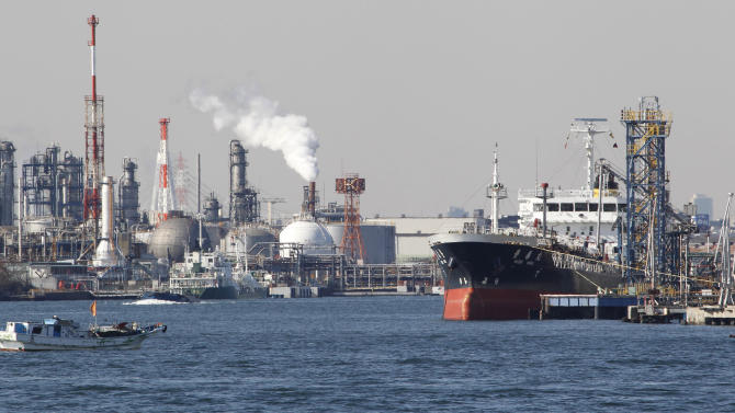 FILE - In this Feb. 20, 2012 file photo, an oil tanker is moored at an oil loading platform adjacent to an oil refinery in Kawasaki, west of Tokyo, as Japan posted a record high trade deficit in January after its nuclear crisis shut down nearly all the nation's reactors for tougher checks, sending fuel imports surging. The Fukushima crisis is erasing years of Japanese efforts to reduce greenhouse gas emissions blamed for global warming, as power plants running on oil and natural gas fill the electricity gap left by now-shuttered nuclear reactors. (AP Photo/Koji Sasahara, File)