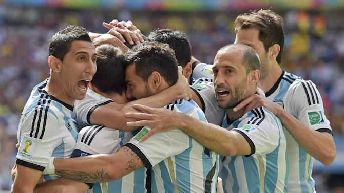 Argentina players celebrate after Gonzalo Higuain scored the opening goal during the World Cup quarterfinal soccer match between Argentina and Belgium at the Estadio Nacional in Brasilia, Brazil, Saturday, July 5, 2014
