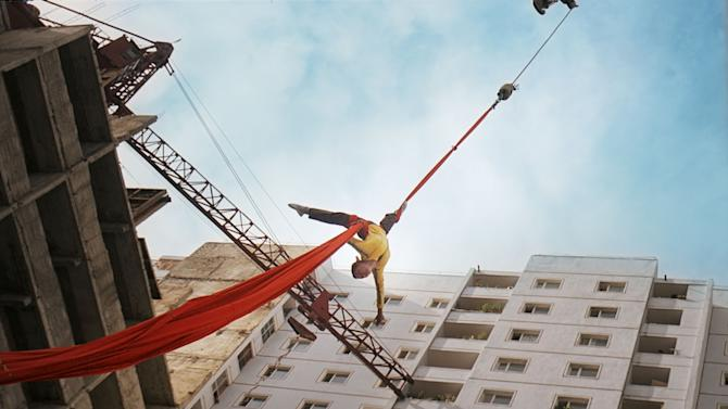 """In this image made out of film """"Comrade Kim Goes Flying"""" released by Another Dimension of An Idea/Koryo Group, Comrade Kim Yong Mi played by Han Jong Sim is pulled up in the air by a crane. It's a classic tale of a small town girl who follows her dreams to the big city. But in this case, the girl is a North Korean coal miner, the big city is Pyongyang and her dream is to become a high-flying trapeze artist. """"Comrade Kim Goes Flying,"""" a collaboration between a North Korean director and two European filmmakers, makes its world premiere Saturday, Sept. 8, 2012 at the Toronto International Film Festival before it heads to Pyongyang later this month for its North Korean debut.  (AP Photo/Courtesy of Another Dimension of An Idea/Koryo Group) EDITORIAL USE ONLY"""