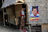 File photo shows a campaign poster for Andal Ampatuan Snr in Maguindanao southern Philippines. The patriarch of the clan is blamed for the Philippines&#39; worst political killing in history. Their power may have been diminished and their leaders in jail, but the Ampatuan clan continues to cast a menacing shadow over its fiefdom