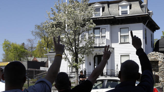 Protesters gesture outside the Graham, Putnam, and Mahoney Funeral Parlors in Worcester, Mass., Monday, May 6, 2013, where the body of killed Boston Marathon bombing suspect Tamerlan Tsarnaev is being prepared for burial. Funeral director Peter Stefan has pleaded for government officials to use their influence to convince a cemetery to bury Tsarnaev, but so far no state or federal authorities have stepped forward. (AP Photo/Elise Amendola)
