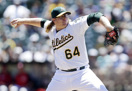 Griffin gets first win in month, A's beat Reds 5-0