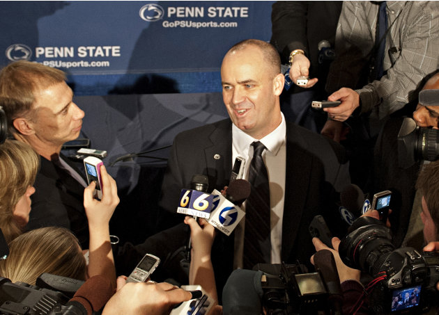 Penn State's new football coach Bill O'Brien is surrounded by the media after he was introduced during an NCAA college football news conference, Saturday, Jan. 7, 2012, in State College, Pa. O'Brien, 