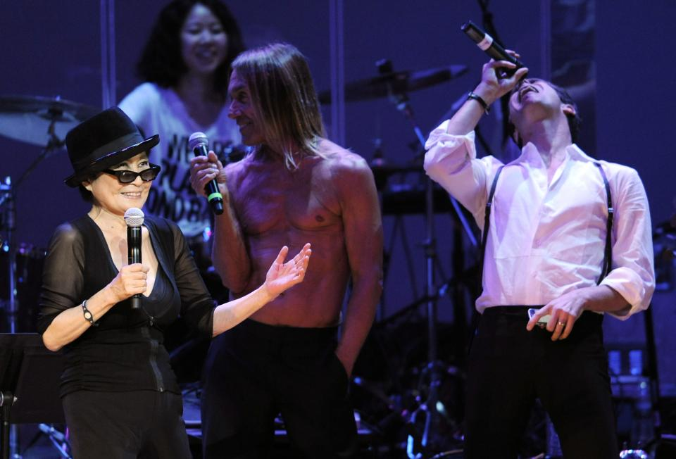 "Yoko Ono, left, performs alongside special guests Iggy Pop, center, and Perry Farrell during the ""Yoko Ono: We Are Plastic Ono Band"" concert at the Orpheum Theater in Los Angeles, Friday, Oct. 1, 2010. (AP Photo/Chris Pizzello)"
