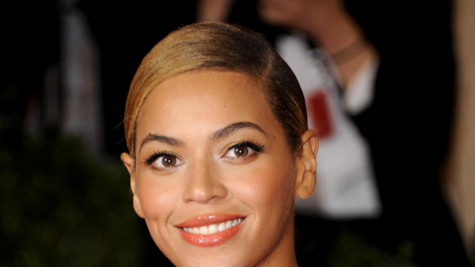 FILE - This May 7, 2012 file photo shows Beyonce Knowles at the Metropolitan Museum of Art Costume Institute gala benefit, celebrating Elsa Schiaparelli and Miuccia Prada in New York. HBO announced Monday, Nov. 26, 2012, that a documentary about the Grammy-winning singer will debut Feb. 16, 2013. Beyonce is directing the film and it will include footage she shot herself with her laptop. (AP Photo/Evan Agostini, File)