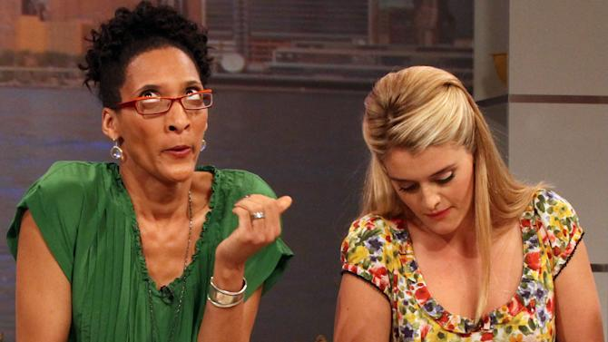 """This Friday, Aug. 26, 2011 photo shows co-hosts Carla Hall, left, and Daphne Oz as they prepare a dish during a rehearsal for ABC's """"The Chew"""" in New York. Can some of food and style TV's biggest stars help ABC soap fans get over cancellation of their favorite stories? The network's counting on it for """"The Chew.""""     (AP Photo/Tina Fineberg)"""