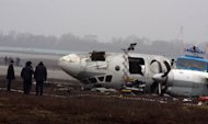 <p>               Ukrainian AN-24 plane is seen after crash outside an airport in the eastern Ukrainian city of Donetsk, Thursday, Feb. 14, 2013. A passenger plane carrying soccer fans headed for a match between Shakhtar and Borussia Dortmund, skidded past the landing strip and overturned on Wednesday, killing five people, officials said. The plane was carrying 44 passengers and crew  from the Black Sea port of Odessa when it crash-landed. (AP Photo/Irina Gorbaseva)