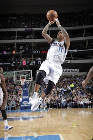 Ellis scores 26 and Mavericks hold off Jazz 103-93