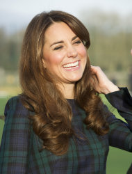 FILE - Kate, the Duchess of Cambridge seen during her visit to St. Andrews School, where she attended school, in Pangbourne, England, in this file photo dated Friday, Nov. 30, 2012. The Duke and Duchess of Cambridge are very pleased to announce that the Duchess of Cambridge is expecting a baby, St James&#39;s Palace officially announced Monday Dec. 3, 2012. (AP Photo/Arthur Edwards, File)