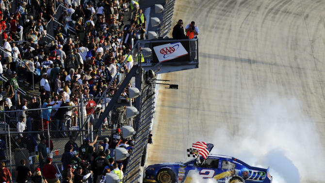 Brad Keselowski performs a burnout after winning the NASCAR Sprint Cup Series auto race, Sunday, Sept. 30, 2012, at Dover International Speedway in Dover, Del. (AP Photo/Nick Wass)