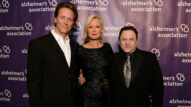 From left, actor Steven Weber, Alzheimer's Association's Laurie Grad,  and actor Jason Alexander arrive at the 21st Annual 'A Night at Sardi's' to benefit the Alzheimer's Association at the Beverly Hilton Hotel on Wednesday, March 20, 2013 in Beverly Hills, Calif. (Photo by Jordan Strauss/Invision for Alzheimer's Association/AP Images)