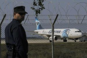 A policeman stands guard at Larnaca Airport near a …