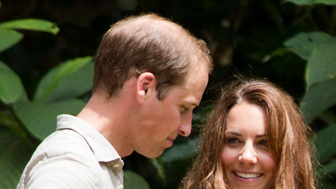 Britain's Prince William, left, and Kate, the Duchess of Cambridge speak to each other during their visit at the Borneo Rainforest Lodge in Danum Valley, some 70 kilometers (44 miles) west of Lahad Datu, on the island of Borneo Saturday, Sept. 15, 2012. (AP Photo/Mohd Rasfan, Pool)