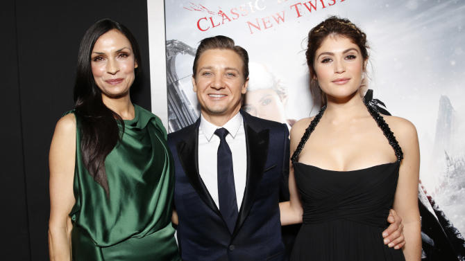 """Famke Janssen, Jeremy Renner and Gemma Arterton attend the premiere of """"Hansel & Gretel Witch Hunters"""" on Thursday Jan. 24, 2013, in Los Angeles.  (Photo by Todd Williamson/Invision/AP)"""