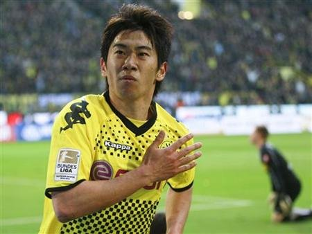 Borussia Dortmund's Kagawa celebrates a goal against Borussia Moenchengladbach during their German first division Bundesliga soccer match n Dortmund