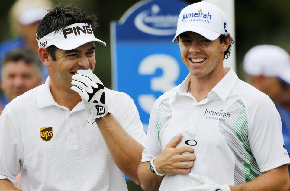 Louis Oosthuizen, left, of South Africa, and Rory McIlroy, of Northern Ireland, laugh while waiting to tee off on the third hole during the third round of the Deutsche Bank Championship PGA golf tournament at TPC Boston in Norton, Mass., Sunday, Sept., 2, 2012. (AP Photo/Michael Dwyer)