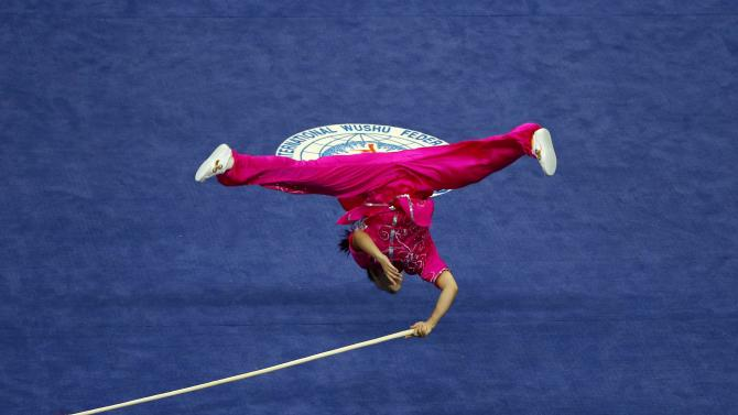 Macau's Li Yi competes in the women's qiangshu final during the wushu competition at the Ganghwa Dolmens Gymnasium, during the 17th Asian Games in Incheon