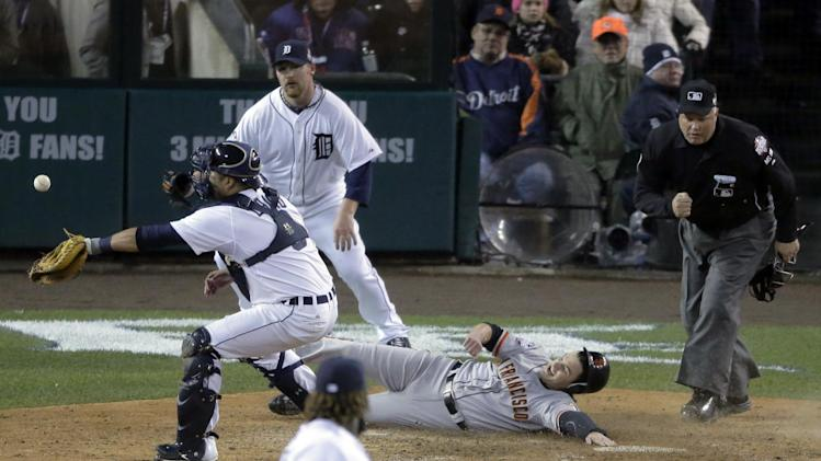 San Francisco Giants second baseman Ryan Theriot slides safely to score a run past Detroit Tigers catcher Gerald Laird during the 10th inning of Game 4 of baseball's World Series against the Detroit Tigers Sunday, Oct. 28, 2012, in Detroit. (AP Photo/Charlie Riedel)