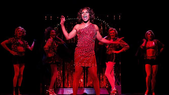 """FILE - This file publicity image released by The O+M Company shows Billy Porter during a performance of """"Kinky Boots."""" The current Tony Award winning musical grossed $1,912,568 over eight performances during the week ending Sunday, Dec. 1, 2013, smashing the all-time house record at the Al Hirschfeld Theatre. It beat out the crown there held by the recent revival of """"How To Succeed in Business Without Really Trying,"""" which had one more performance. (AP Photo/The O+M Company, Matthew Murphy, File)"""