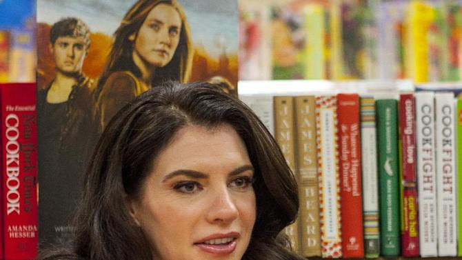 """Writer of """"The Host"""" and the """"Twlight"""" Saga, Stephenie Meyer, during """"The Host"""" during """"The Host"""" book signing at the Anderson's Bookshop on Monday, March 11, 2013, in Chicago. (Photo by Barry Brecheisen/Invision/AP)"""