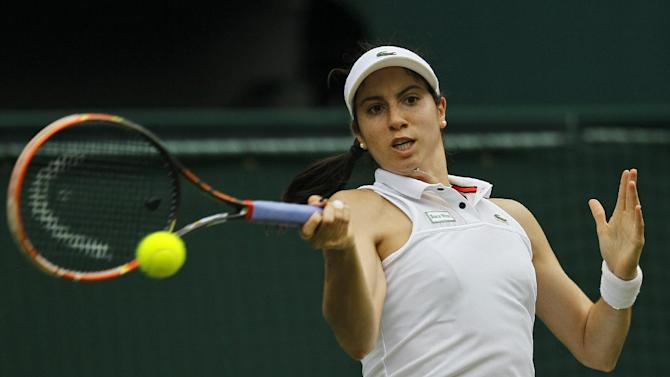 Christina McHale of the United States returns a ball to Sabine Lisicki of Germany during their singles match at the All England Lawn Tennis Championships in Wimbledon, London, Thursday July 2, 2015. (AP Photo/Pavel Golovkin)
