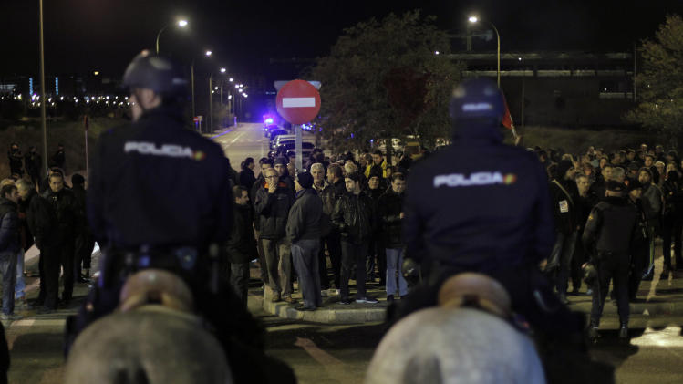 Spain says 32 arrested as general strike begins