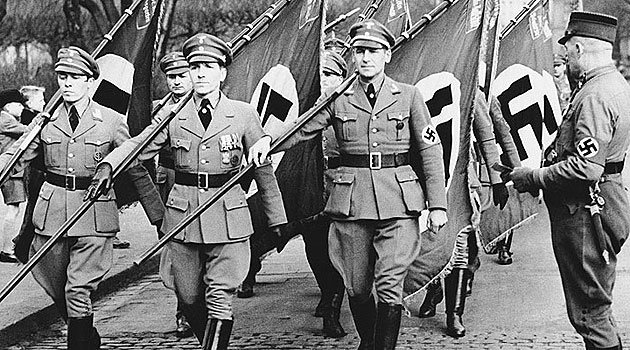 Air Force men with their standards marching through the streets of Cologne, March 8, 1936. (AP Photo)