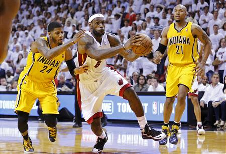 Miami Heat's James drives through Indiana Pacers' defense during their NBA Eastern Conference final basketball playoff in Miami