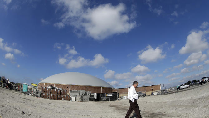 In this Thursday, Dec. 6, 2012 photo, Bob Wells, superintendent of the Edna Independent School District, walks past their new domed gym under construction in Edna, Texas. The hurricane dome, a structure being built in part with money from the Federal Emergency Management Agency, can be used to house first responders or residents evacuated during a storm. (AP Photo/David J. Phillip)