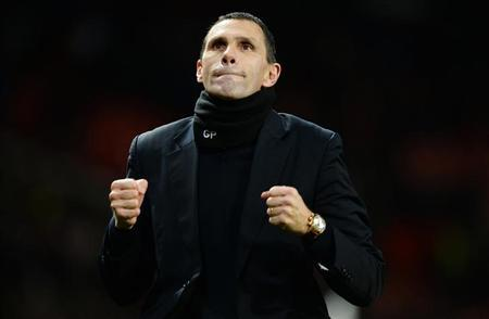 Sunderland's manager Gus Poyet celebrates after their penalty shootout win against Manchester United after their English League Cup semi-final second leg soccer match at Old Trafford, northern Eng