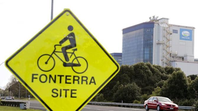 The Fonterra Te Rapa plant is seen behind a sign board for cyclists near Hamilton