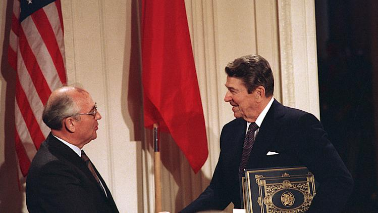 "In this Dec. 8, 1987, file photo, U.S. President Ronald Reagan, right, shakes hands with Soviet leader Mikhail Gorbachev after the two leaders signed the Intermediate Range Nuclear Forces Treaty to eliminate intermediate-range missiles during a ceremony in the White House East Room in Washington. In an escalation of tensions, the Obama administration accused Russia on July 28, 2014, of conducting tests in violation of a 1987 nuclear missile treaty, calling the breach ""a very serious matter"" and going public with allegations that have simmered for some time. The treaty confrontation comes at a highly strained time between President Barack Obama and Russian President Vladimir Putin over Russia's intervention in Ukraine and Russia's grant of asylum to National Security Agency leaker Edward Snowden.(AP Photo/Bob Daugherty, File)"