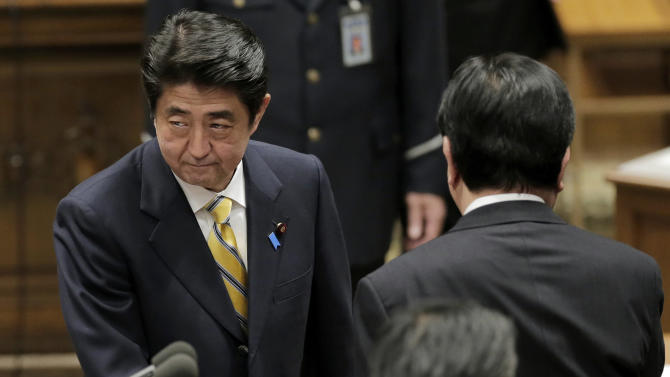 Japan's main opposition Liberal Democratic Party President Shinzo Abe, left, and Japanese Prime Minister Yoshiko Noda, right, leave after their debate at Parliament in Tokyo, Wednesday, Nov. 14, 2012. During the heated parliamentary exchange with Abe, Noda said that he is ready to dissolve the parliament by Friday, bringing an election within weeks, if Japan's main opposition party agrees to key electoral reforms. (AP Photo/Itsuo Inouye)