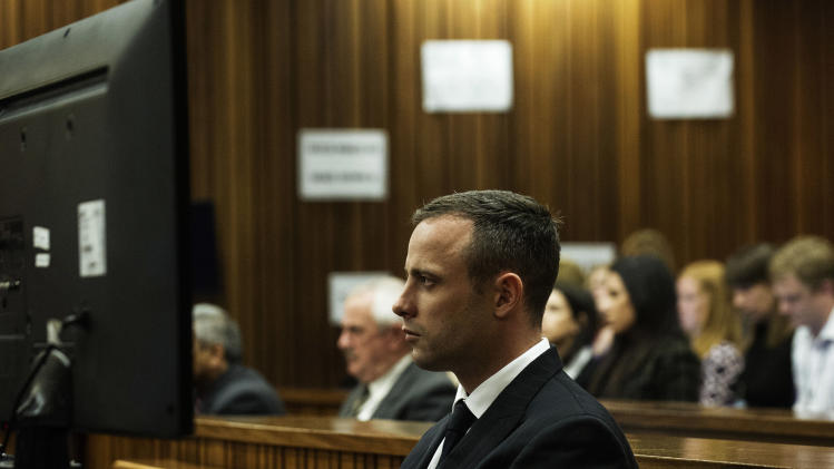 Oscar Pistorius looks straight ahead as he listens to evidence being given in court in Pretoria, South Africa, Wednesday, April 16, 2014. Pistorius is charged with the murder of his girlfriend, Reeva Steenkamp, on Valentines Day in 2013. (AP Photo/Gianluigi Guercia, Pool)