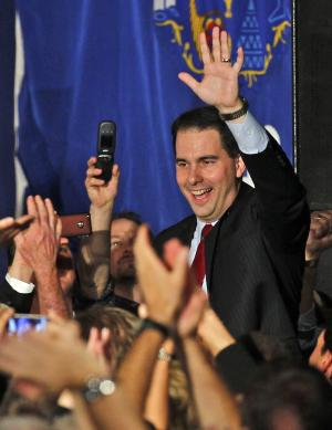 FILE - In this Nov. 2, 2010  file photo, supporters cheer as then Wisconsin Republican gubernatorial candidate Scott Walker enters his victory party in Pewaukee, Wis. More than a year after the standoff over union rights that rocked Wisconsin and the nation for weeks, the Republican Governor will face Milwaukee's Democratic Mayor Tom Barrett in Tuesday's recall election.  (AP Photo/Jeffrey Phelps, File)