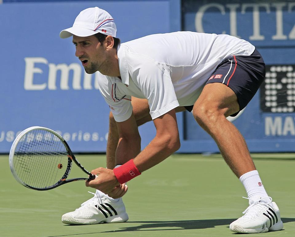 Novak Djokovic, from Serbia, waits for a serve from Juan Martin del Potro, from Argentina, during a semifinal match at the Western & Southern Open tennis tournament, Saturday, Aug. 18, 2012, in Mason, Ohio. (AP Photo/Al Behrman)
