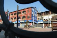 A paramilitary soldier walks on a deserted street during a curfew in Srinagar, on February 9, 2013. Kashmiri separatist Mohammed Afzal Guru has been executed in New Delhi over his role in a deadly attack on the Indian parliament in 2001 -- triggering protests on both sides of the border in disputed Kashmir