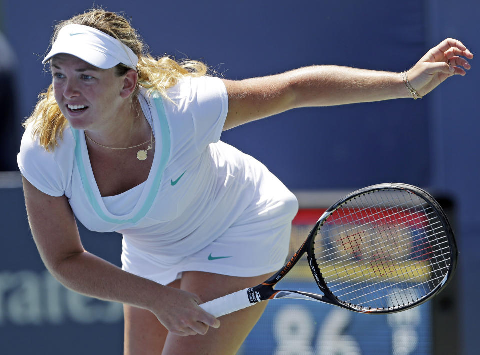 Coco Vandeweghe, of the United States, follows through on a serve to Yanina Wickmayer, of Belgium, during a semifinal of the Bank of the West tennis tournament Saturday, July 14, 2012 in Stanford, Calif. (AP Photo/Marcio Jose Sanchez)