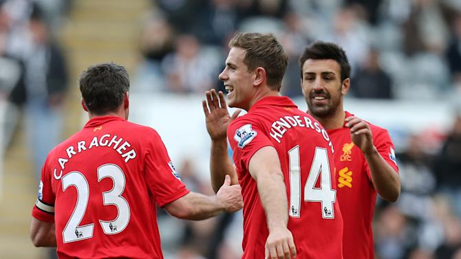 Liverpool's Jordan Henderson, center, celebrates his goal with his teammates during their English Premier League soccer match against Newcastle United at St James' Park, Newcastle, England, Saturday, April 27, 2013. (AP Photo/Scott Heppell)