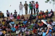 Indian cricketer Virat Kohli plays a shot during the opening one-day international match between Sri Lanka and India at the Suriyawewa Mahinda Rajapakse International Cricket Stadium in the southern district of Hambantota. Kohli hit an impressive century to set up India's 21-run victory over Sri Lanka