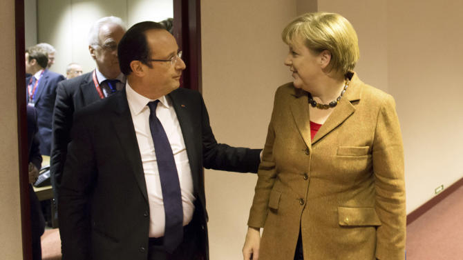 French President Francois Hollande, center, greets German Chancellor Angela Merkel prior to a bilateral meeting during an EU summit in Brussels on Thursday, Nov. 22, 2012. EU leaders begin what is expected to be a marathon summit on the budget for the years 2014-2020. The meeting could last through Saturday and break up with no result and lots of finger-pointing. (AP Photo/Bertrand Langlois, Pool)