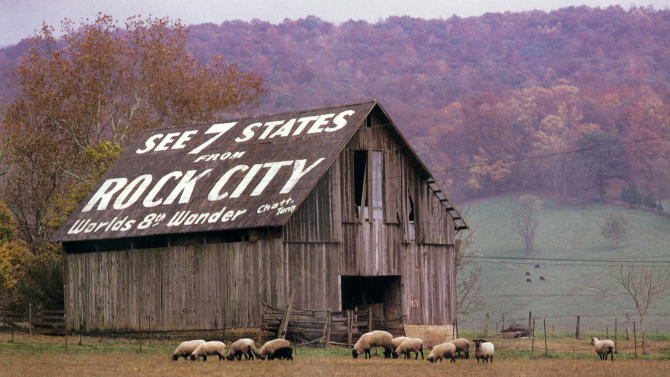 This 1996 photo provided by Rock City Gardens shows an advertisement for the attraction painted on the side of a barn in Cumberland County, Tenn., one of 900 barn ads originally painted by Clark Byers beginning in the 1930s. Rock City is a popular tourist attraction located in Lookout Mountain, Ga., and is celebrating its 80th year. (AP Photo/Rock City Gardens, David B. Jenkins)